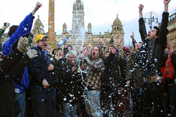 Revellers-spray-a-bottle-of-champagne-as-they-celebrate-the-death-of-former-British-prime-minister-Margaret-Thatcher-at